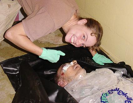 May 20: Specialist Sabrina Harman, 26, grins as she poses alongside the corpse of an Iraqi detainee in Abu Ghraib prison. The photograph was obtained by ABC News, which identified the dead man as Manadel al-Jamadi. The broadcaster has evidence that the man was brought to the prison by US navy seals in good health.