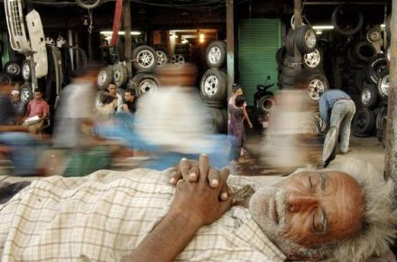 Raghu Rai - Rickshawman taking a nap in Jama Masjid Market, Delhi, 2005