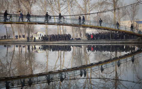 pyongyang-north-korea-pedestrians-and-cyclists-reflected-in-the-river-pothong-as-they-cross-a-bridge-at-the-start-of-their-working-day-wong-maye