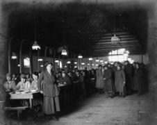 OLIVE EDIS; IWM PHOTOGRAPHER OF THE WOMEN'S SERVICES IN FRANCE 1919 (Q 8060) The dining room of a Queen Mary's Army Auxiliary Corps (QMAAC) camp at Bourges, France, circa 1919. Copyright: © IWM. Original Source: http://www.iwm.org.uk/collections/item/object/205214331